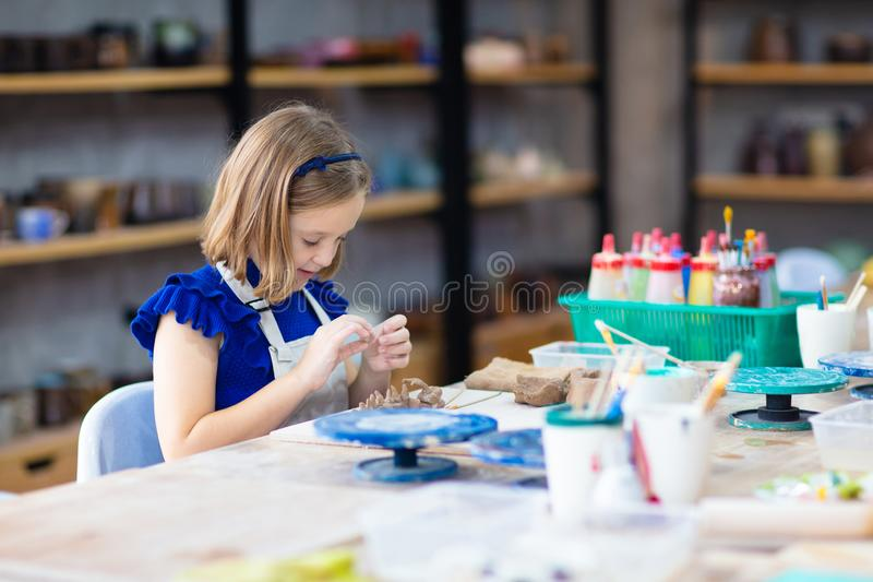 Child at pottery wheel. Kids arts and crafts class stock photography