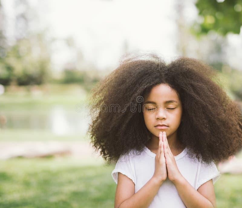 Child praying royalty free stock photography