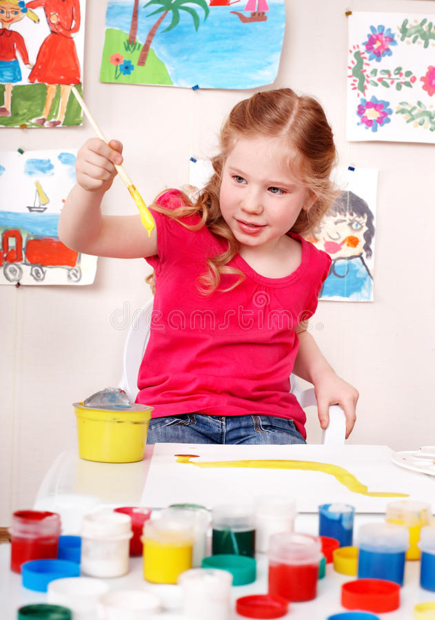 Child preschooler painting picture in play room. royalty free stock images