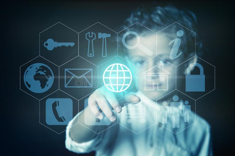 Child pressing the button with the world wide web icon on a virtual screen stock images