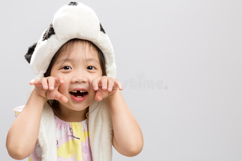 Child Pretending Animal Background / Child Pretending Animal / Child Pretending Animal, Panda, Studio Isolated Background. Pretty Asian girl pretending to be royalty free stock photography