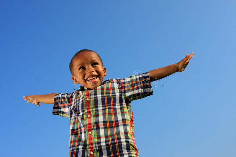 Child Pretending To Fly Royalty Free Stock Photography