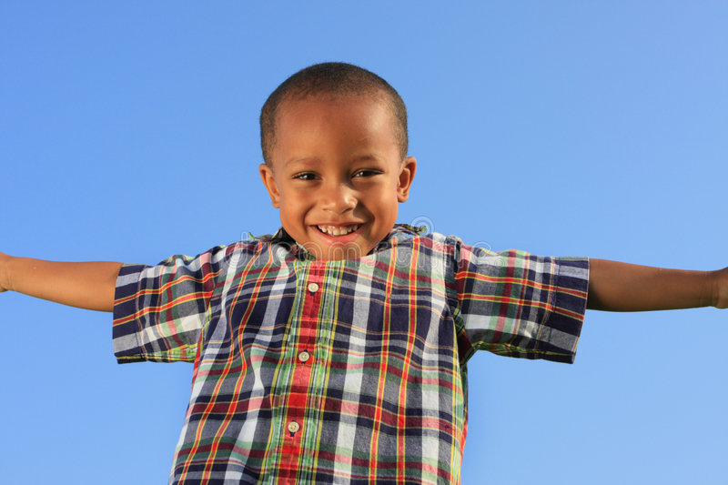 Download Child Pretending to Fly stock photo. Image of black, believe - 5489322
