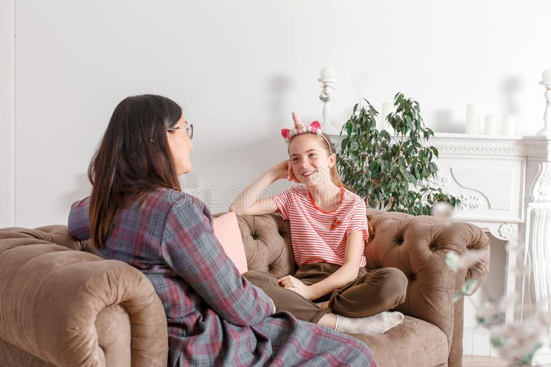 Child psychologist talking with a teenage girl in his office. Psychological assistance to children. Teenager girl smiling royalty free stock image