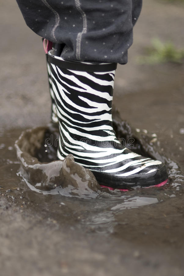 Download Child In A Puddle Stock Photography - Image: 16974772