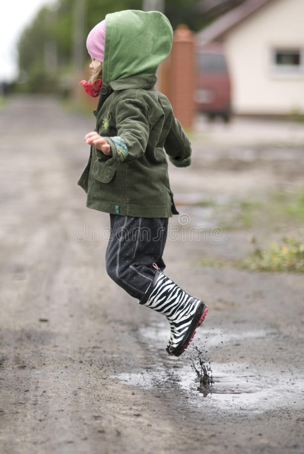 Child in a puddle royalty free stock photo
