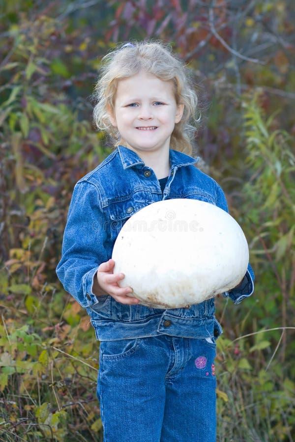 Child with Puff ball mushroom. royalty free stock image