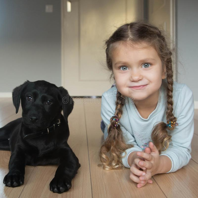 Child and puppy are happy. Animal care concept stock images