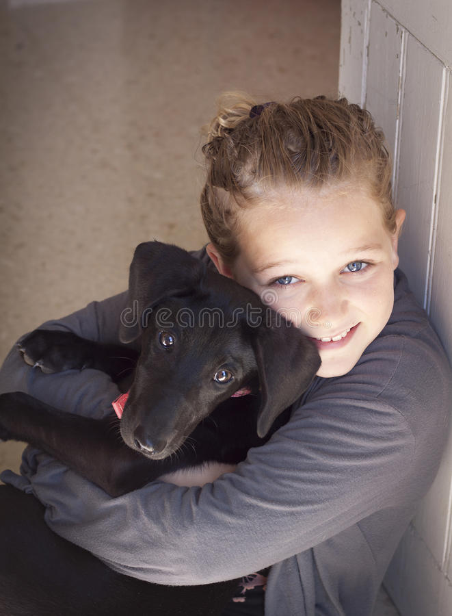 Child with puppy stock images