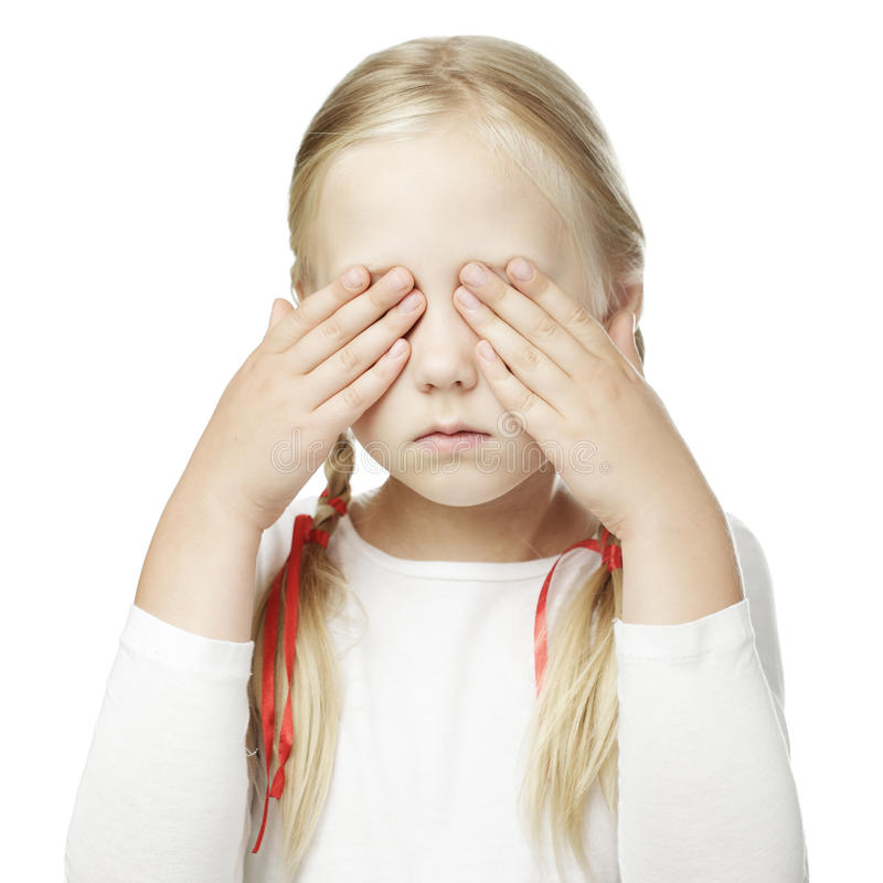 Child puts his hand over his eyes royalty free stock photography