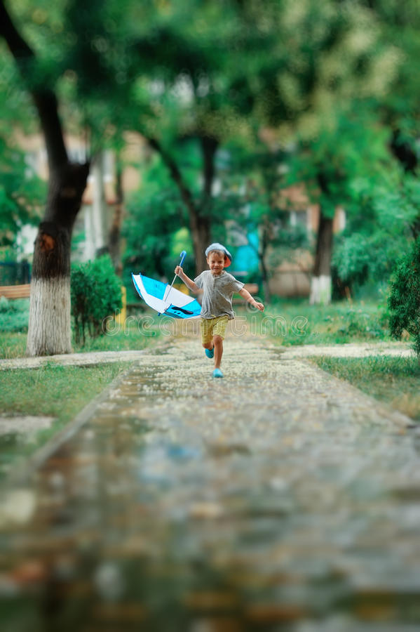 Child In The Rain Stock Images