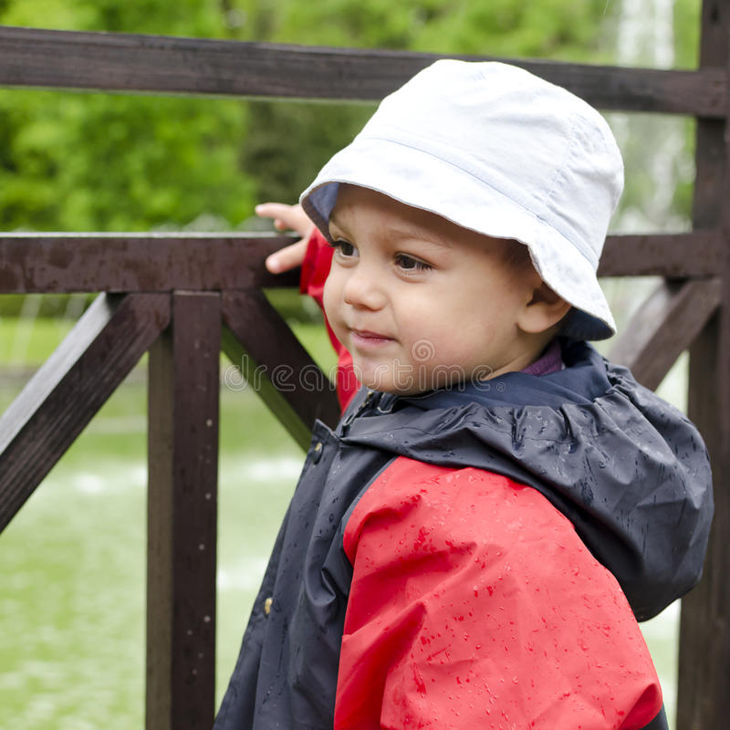 Download Child in rain stock photo. Image of childhood, rainy - 31218314