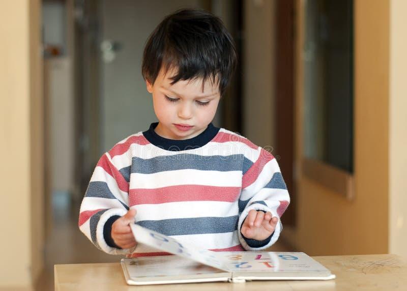 Child reading royalty free stock photo
