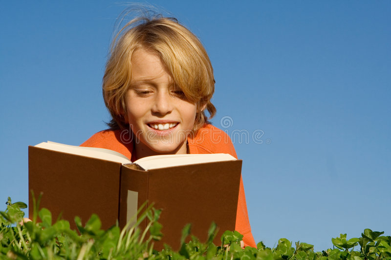 Child reading book or bible royalty free stock photography