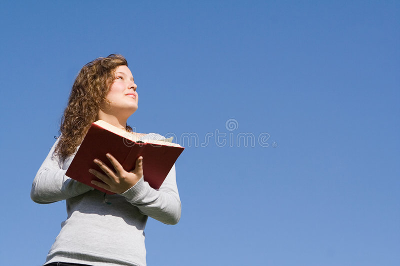Child reading book or bible royalty free stock photos