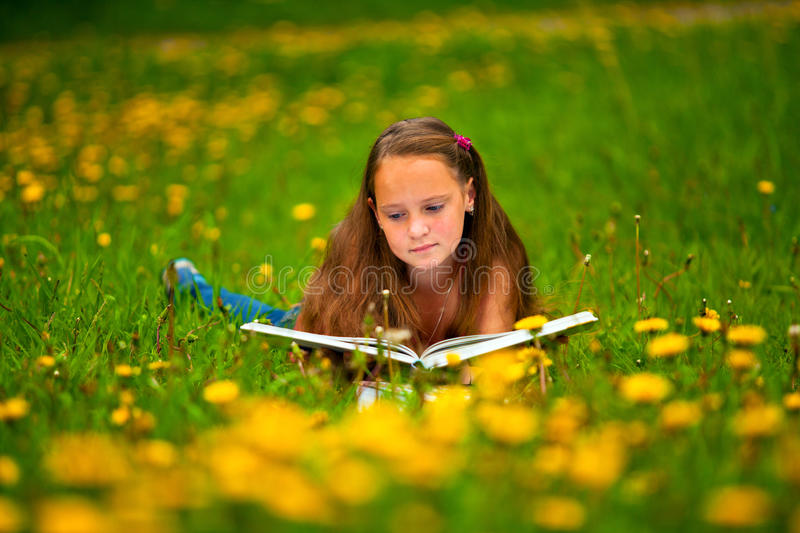 Download Child Reading A Book While Lying Stock Photos - Image: 28769513