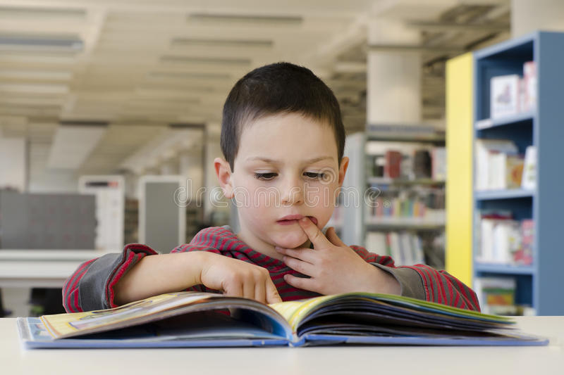 Child reading royalty free stock photography