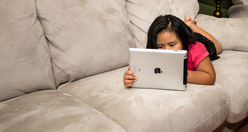 Child reading on iPad royalty free stock images