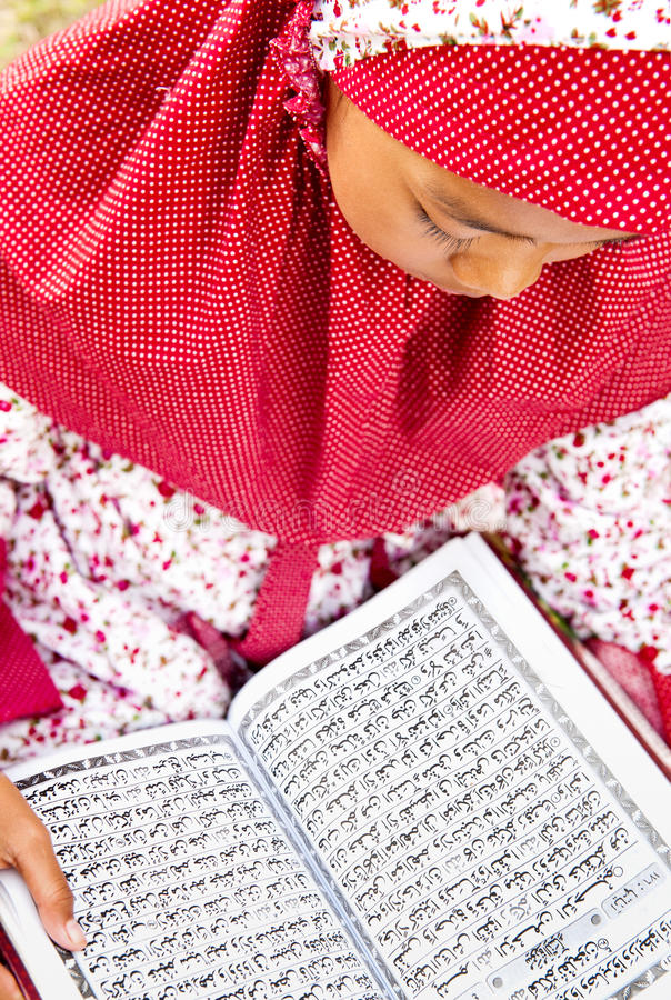 Download Child Reading Koran stock image. Image of concentrate - 18065619