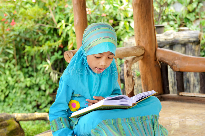 Download Child Reading Koran, Indonesia Stock Image - Image: 13488271