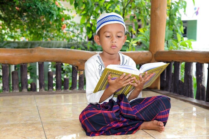 Child Reading Koran, Indonesia Stock Images