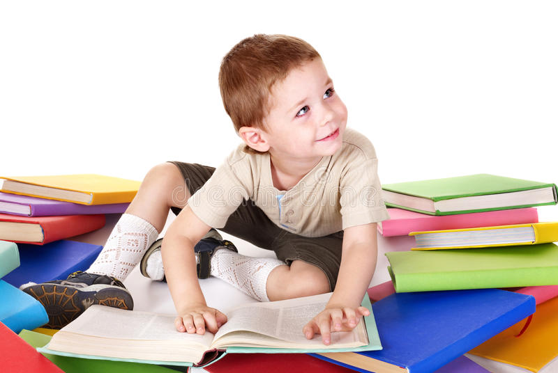 Download Child Reading Pile Of Books. Royalty Free Stock Photos - Image: 15948088