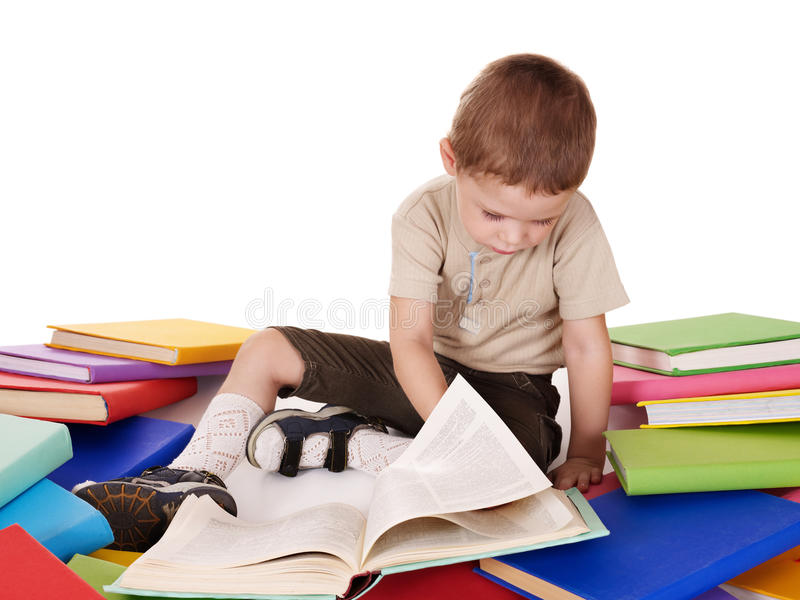 Child reading pile of books. royalty free stock image