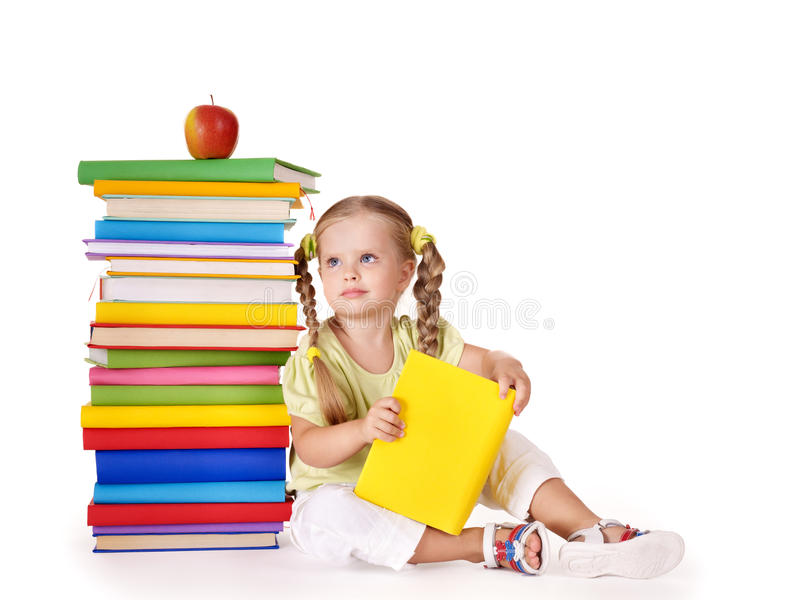 Child reading stack of books. stock images