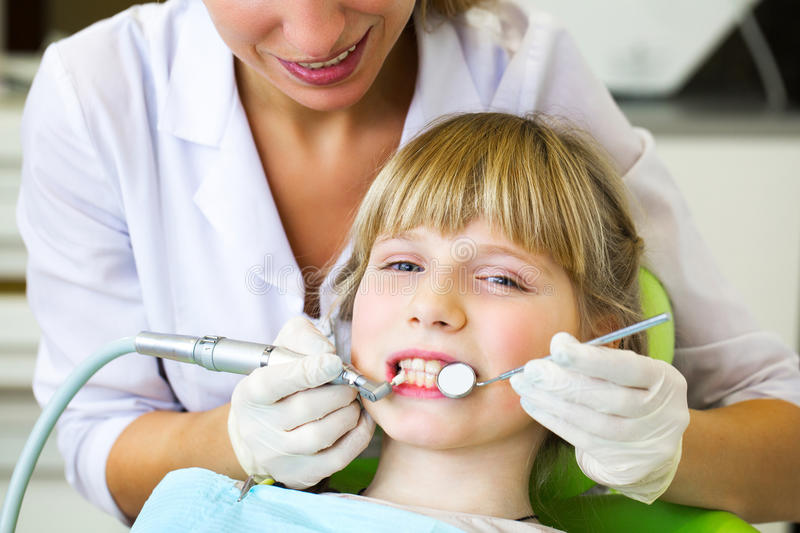 Child on reception at the dentist. reception at the dentist.Close up portrait of a little smiling girl at dentist stock photos