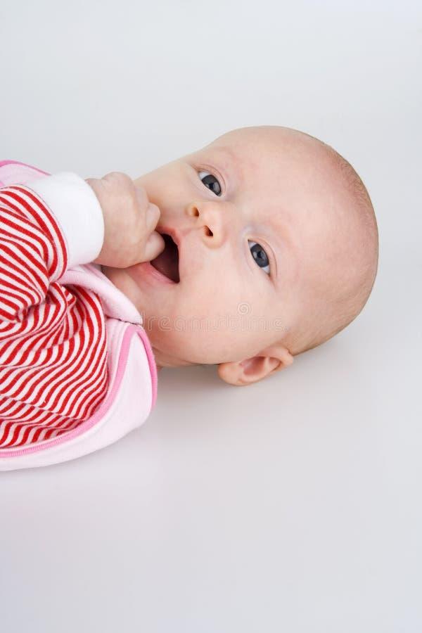 Child recumbent. Child recumbent piggyback on white background stock images