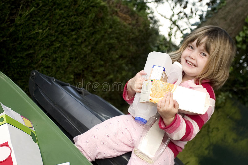 Child recycling stock photography