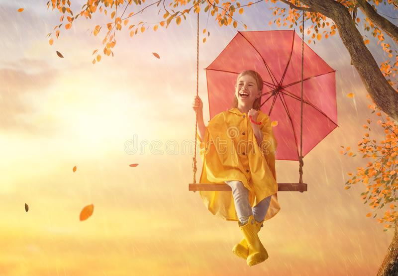 Child with red umbrella stock image
