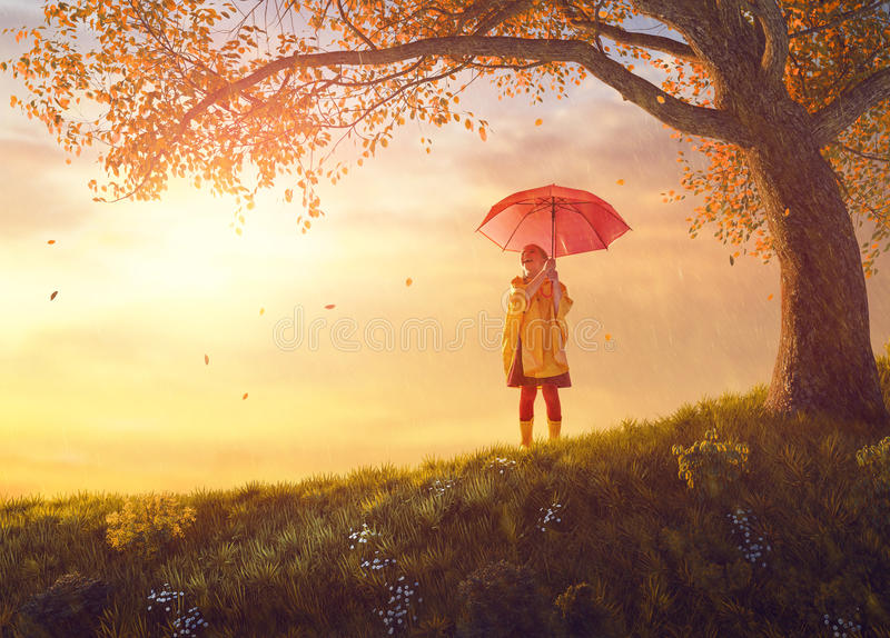 Child with red umbrella royalty free stock photography