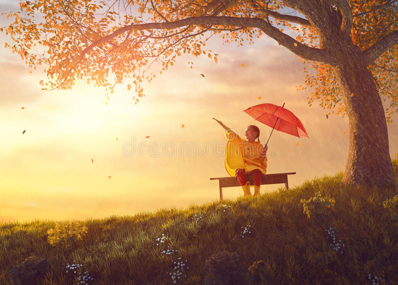 Child with red umbrella royalty free stock image