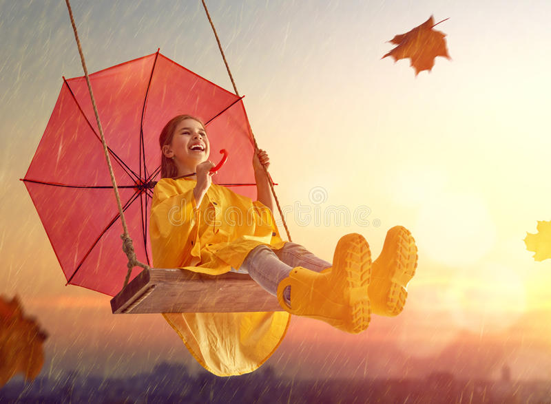 Child with red umbrella royalty free stock photos