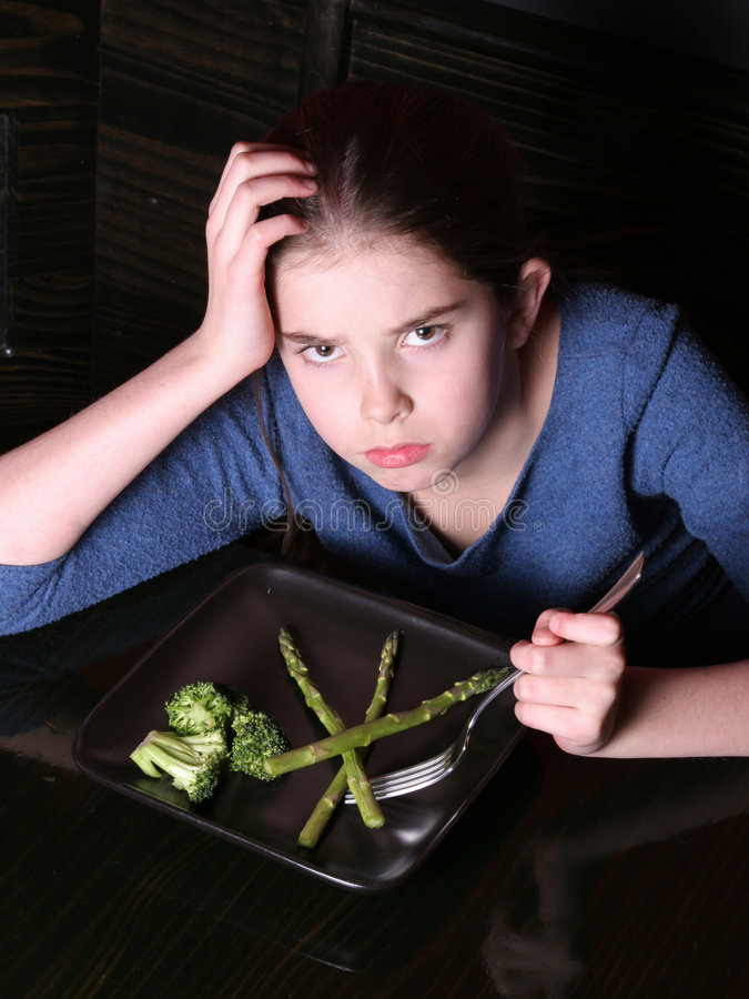 Child Refusing Vegetables royalty free stock image