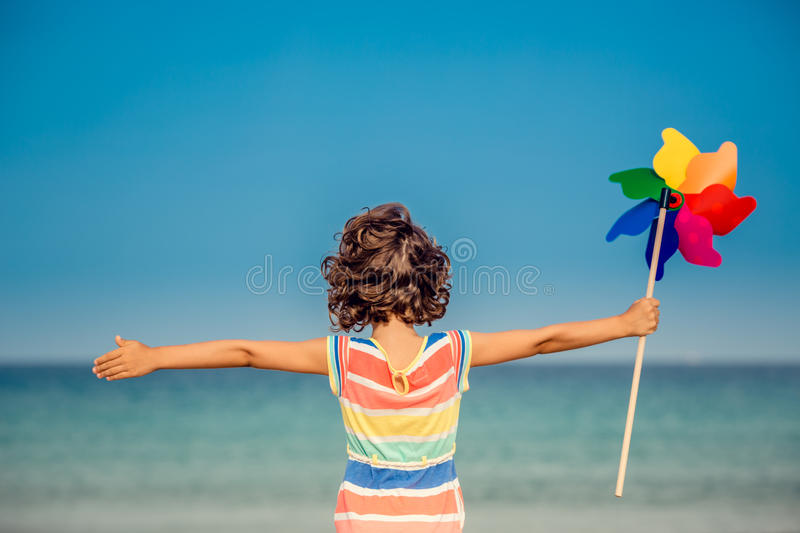 Child relaxing on the beach stock photos