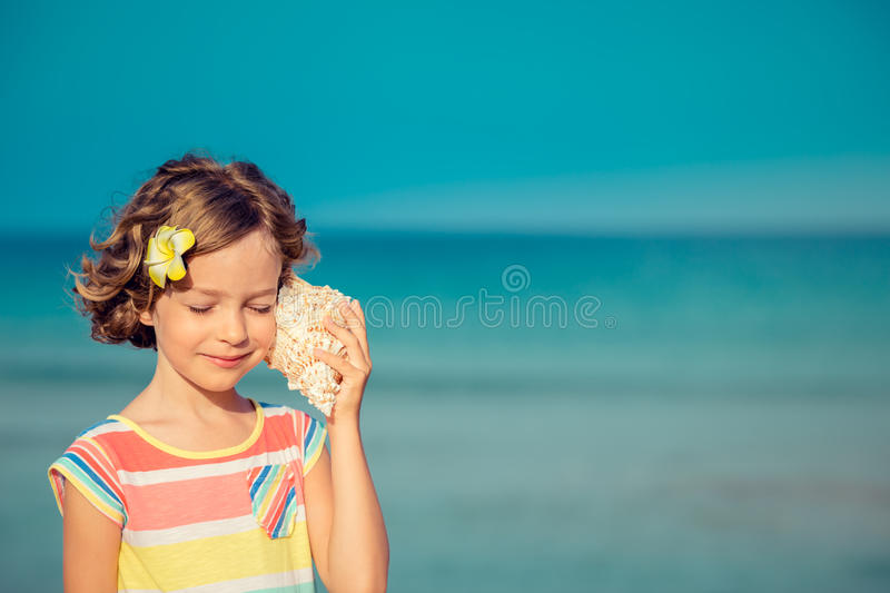 Child relaxing on the beach stock photo