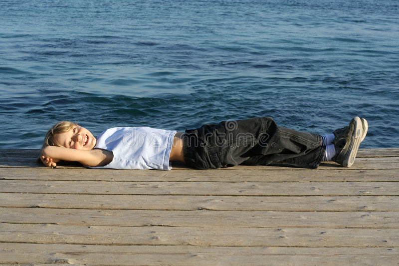 child relaxing, vacation stock photography