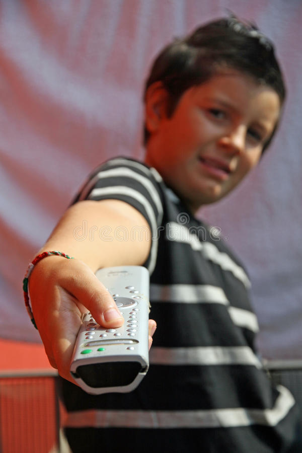 Download Child With Remote Control Changes Channels On TV Royalty Free Stock Photography - Image: 34058087