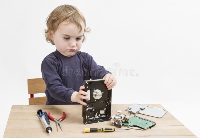 Child Repairing Hard Disk Drive Royalty Free Stock Photo