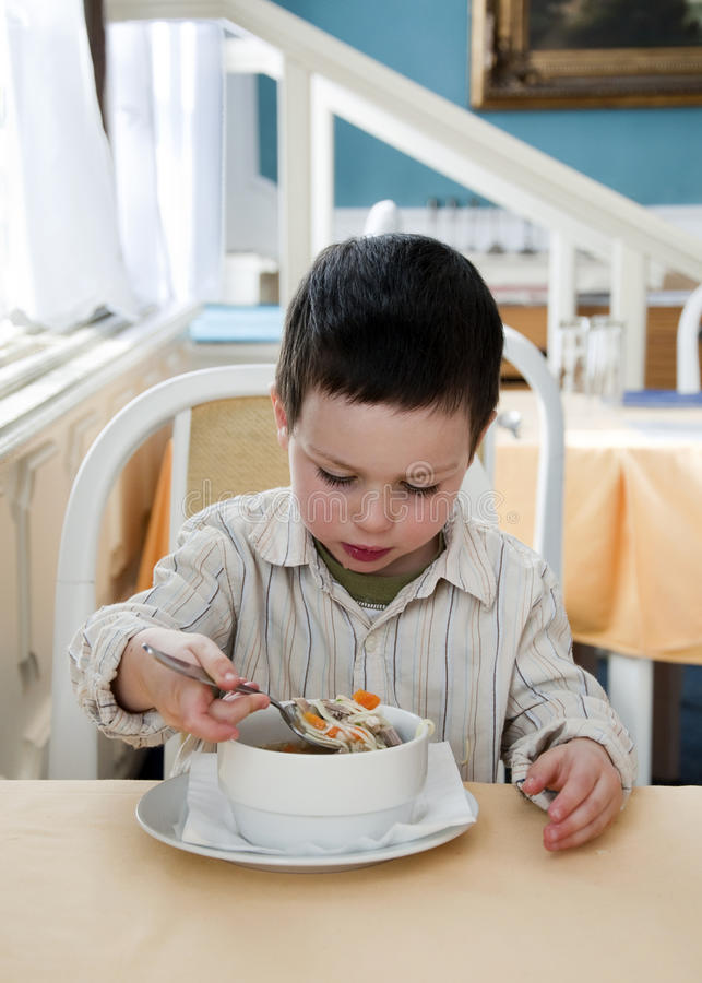 Child At Restaurant Stock Image