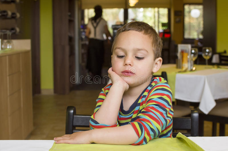 Child in restaurant royalty free stock photo