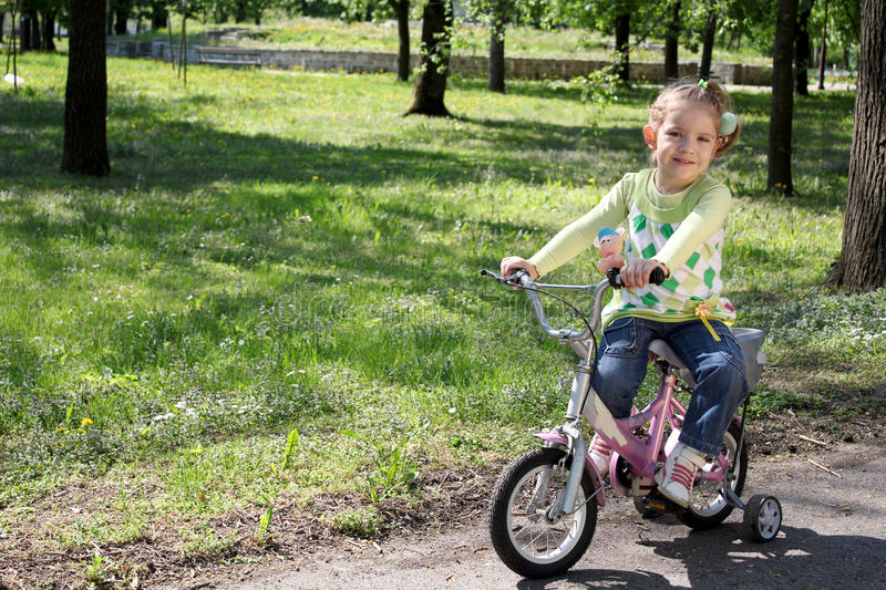 Child Riding Bicycle Stock Photo
