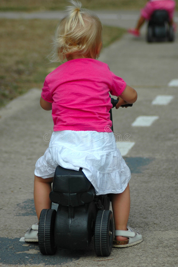 Child Riding Bike Royalty Free Stock Images