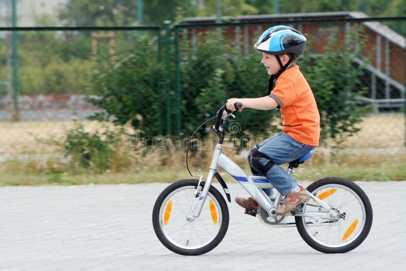 Child riding bike stock image
