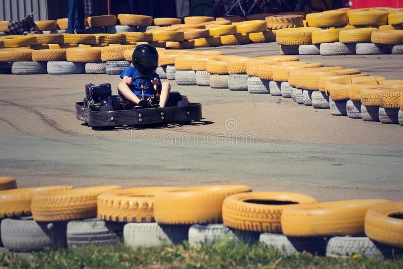 a child riding on the map on the kart track editorial image image