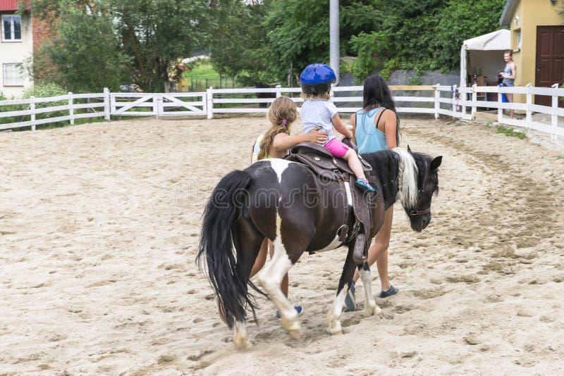 Child riding pony royalty free stock photo