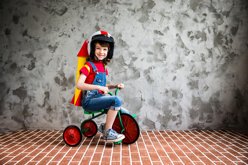 Child riding a retro bicycle stock photo