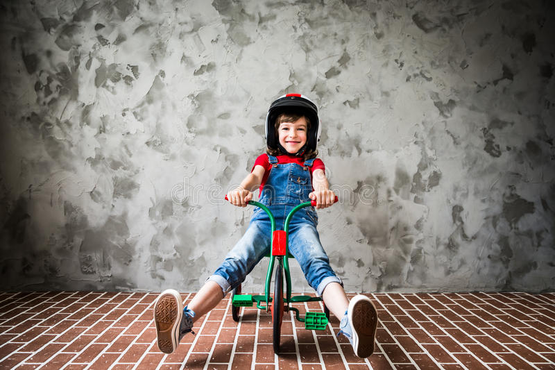 Child riding on retro bicycle royalty free stock image